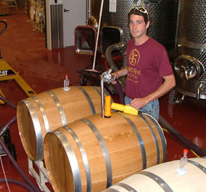 Shawn-Walters-filling-barrels at Forty-Five North Winery